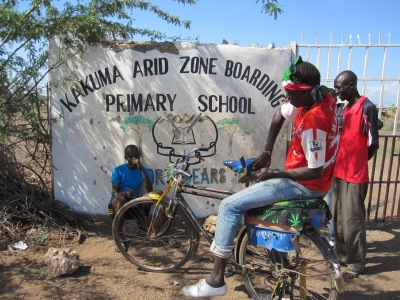 Boy with a taxi bike in Kakuma, Kenya